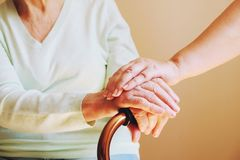 Senior woman with her caregiver at home. Concept senior people health care. Stock Image