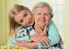 Senior woman with her caregiver. Stock Photos