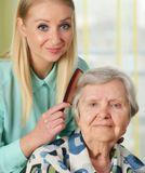 Senior woman with her caregiver. Royalty Free Stock Photos