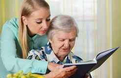 Senior woman with her caregiver. Royalty Free Stock Photography