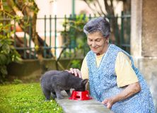 Senior woman with her cat Royalty Free Stock Images