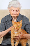 Senior woman and her cat Stock Image