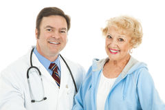 Senior Woman and Her Doctor. Pretty senior woman with her friendly, caring doctor.  Isolated on white Stock Photo