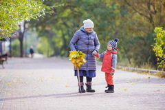 Senior woman and her great grandson on walk in park Royalty Free Stock Image