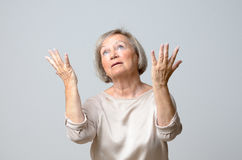 Senior woman with her hands up to the sky Stock Photos