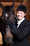 Senior woman with her horse Royalty Free Stock Photos