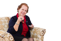 Senior Woman at her Seat Inviting to Have a Tea Royalty Free Stock Image
