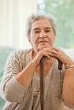 Senior woman with her walking stick Royalty Free Stock Photography