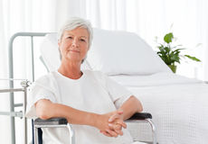 Senior woman in her wheelchair Royalty Free Stock Photos