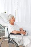 Senior woman in her wheelchair Stock Images