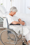 Senior woman in her wheelchair Stock Photo
