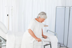Senior woman with her zimmer frame stock images