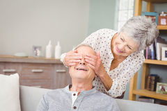 Senior woman hiding eyes of her husband Royalty Free Stock Images