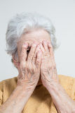 Senior woman hiding her face Royalty Free Stock Images