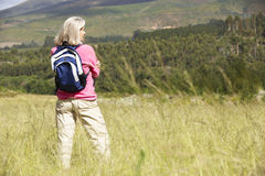 Senior Woman On Hike Through Beautiful Countryside Stock Images