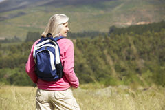 Senior Woman On Hike Through Beautiful Countryside Stock Photos