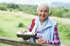 Senior Woman On Hike Having Hot Drink Royalty Free Stock Image