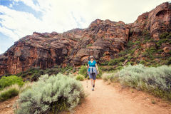 Senior Woman hiking in a beautiful red rock canyon Stock Photo