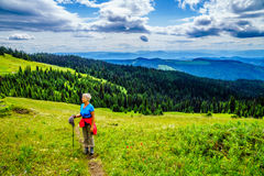 Senior Woman hiking through the Shuswap and enjoying the View on Tod Mountain. Senior Woman enjoying the View on Tod Mountain in the Shuswap Highlands of British royalty free stock photography