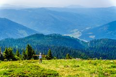 A senior woman on the hillside of Tod Mountain in BC Canada royalty free stock photo