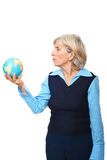Senior woman hold a globe Royalty Free Stock Image