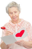 Senior woman hold post-card Royalty Free Stock Photography