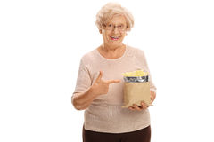 Senior woman holding a bag of chips Stock Photo