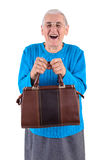 Senior woman holding bag Stock Images