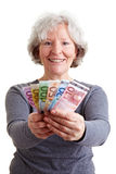 Senior woman holding banknotes Royalty Free Stock Images