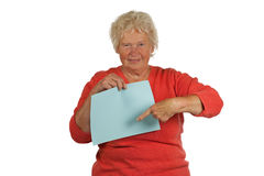 Senior woman holding a blank board Royalty Free Stock Images