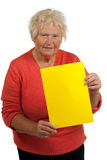 Senior woman holding a blank board Royalty Free Stock Photos