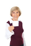 Senior woman holding blank paper Royalty Free Stock Photography