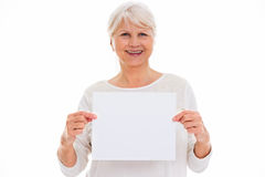 Senior woman holding blank poster Royalty Free Stock Images