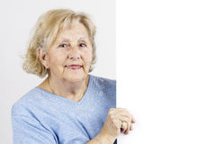 Senior woman holding blank sign Royalty Free Stock Image