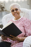 Senior Woman Holding Book Royalty Free Stock Photos