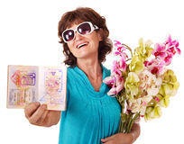 Senior woman holding bunch of flowers. Stock Image