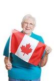 Senior Woman Holding Canada Flag Stock Image