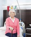 Senior Woman Holding Cane At Rehab Center Stock Photos