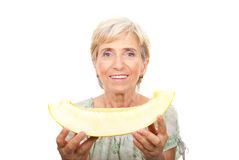 Senior woman holding cantaloupe Stock Photos
