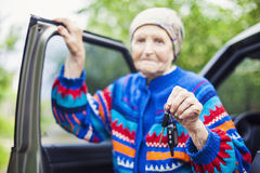 Senior woman holding car key and smiling, selective focus Stock Photography