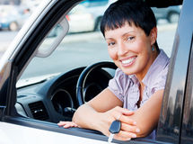 Senior woman holding car key Stock Photo