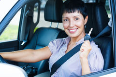 Senior woman holding car key. And smiling to you from a  car Stock Images