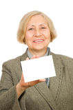 Senior woman holding a card Royalty Free Stock Photo