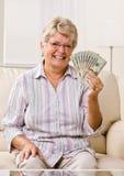 Senior woman holding cash Royalty Free Stock Photography