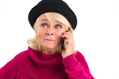 Senior woman is holding cellphone. Stock Photos