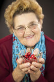 Senior woman holding cherries Stock Photo