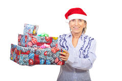 Senior woman holding Christmas gifts Royalty Free Stock Photo