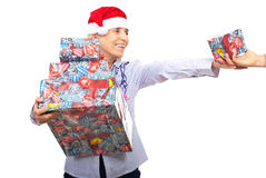 Senior woman holding Christmas presents Stock Photos