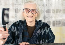 Senior woman holding a comb Stock Photography