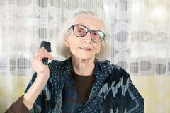 Senior woman holding a comb Royalty Free Stock Photo